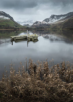 Beautiful Winter landscape image of Llyn Nantlle in Snowdonia Na by Matthew Gibson