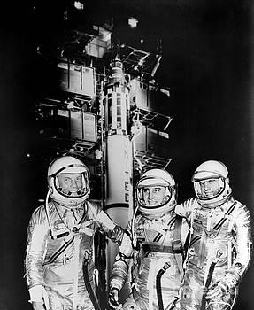 R Muirhead Art - 1961 Mercury astronauts John H Glenn Jr Virgil Grissom and Alan B Shepard Jr standing by Rocket