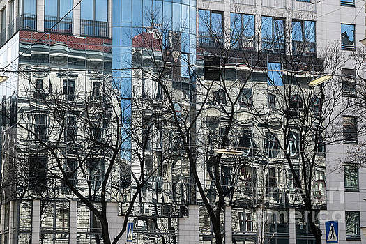 Abstract reflection in high-rise windows  by Jacky Telem