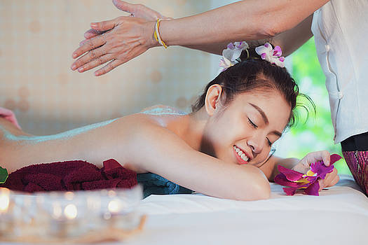 Asian lady relax in skin care aroma therapy  by Anek Suwannaphoom