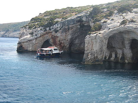 Newnow Photography By Vera Cepic - Boat in the Blue caves on island of Zakinthos shot from the sea