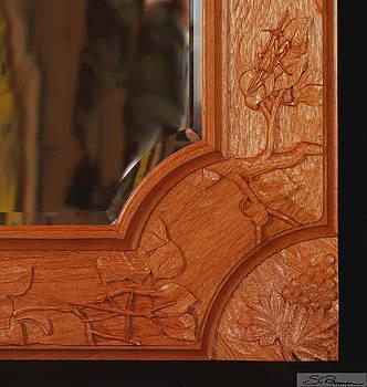 Carved mirror frame by Scott Reuman