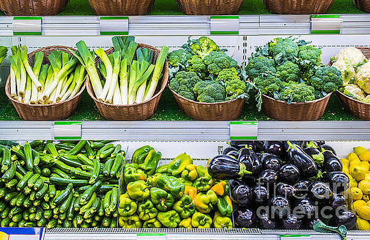 Fruits and vegetables on a supermarket shelf by Deyan Georgiev
