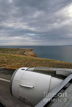 Looking through a window of an Airbus A320 by George Atsametakis