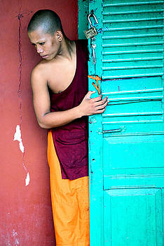Young Cambodian Buddhist shaved head in Sihanoukville by Mirko Dabic