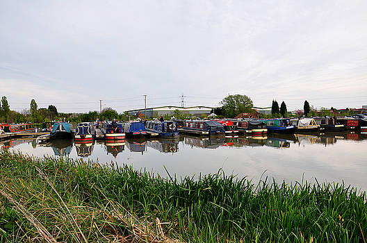 Narrowboats at Barton Marina by Rod Johnson