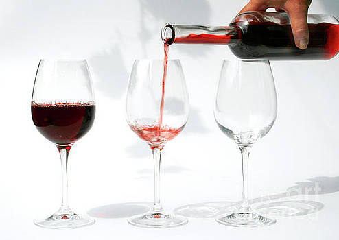 Patricia Hofmeester - pouring red wine into glass