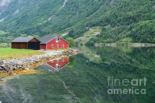Red Wooden House At Norway Fjord by Compuinfoto