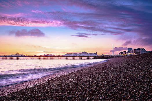 Sunset over Brighton beach by Marius Comanescu