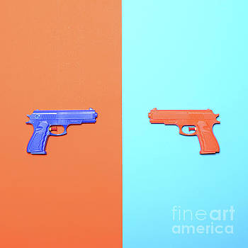 Toy pistols on colorful background  - Minimal design top view by Aleksandar Mijatovic