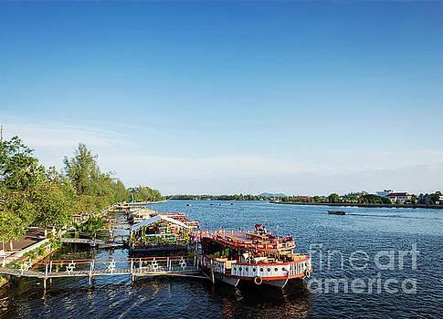 View Of River Boat Restaurants In Kampot Town Cambodia by Jacek Malipan