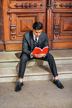 Alexander Image - Young Indonesian American Man reading book in New York