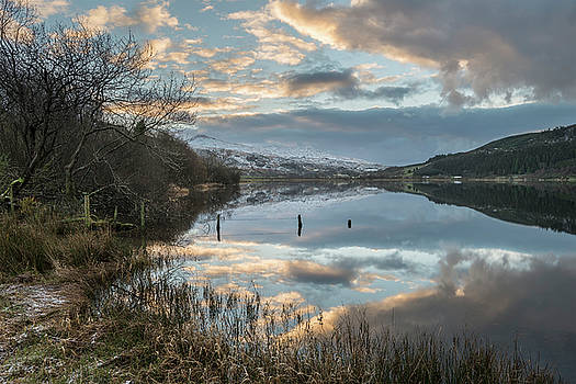 Stunning sunrise landscape image in Winter of Llyn Cwellyn in Sn by Matthew Gibson