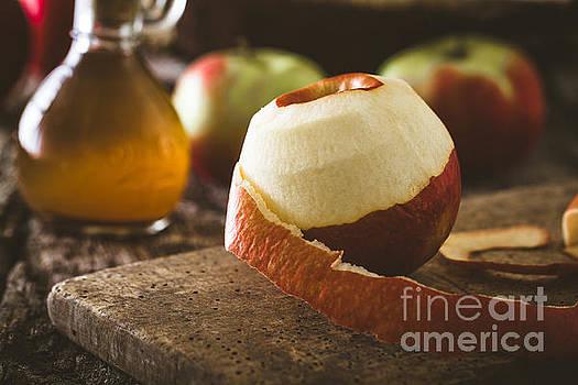 Apple vinegar on wood by Mythja Photography