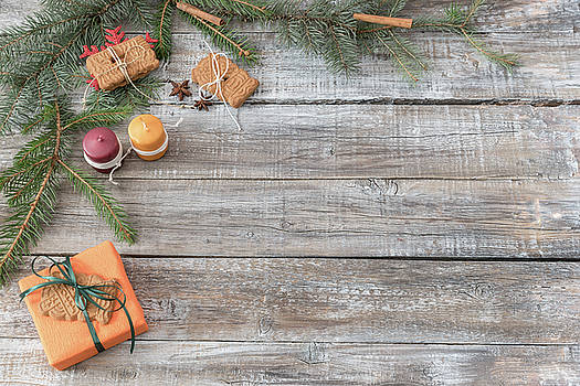 Christmas decorations on a wooden background, top view with copy by Julian Popov