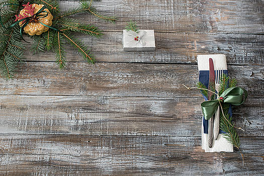 Christmas table place setting with christmas tree branches spoon by Julian Popov