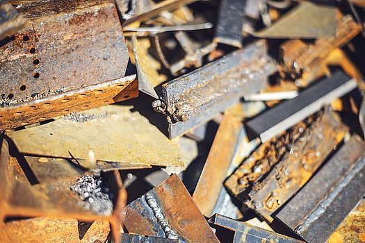 Eduardo Huelin - Closeup pile of scrap metal junk garbage