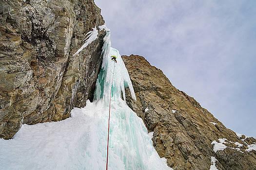 Elijah Weber climbs a route called Preacher rated WI5 near Sun V by Elijah Weber