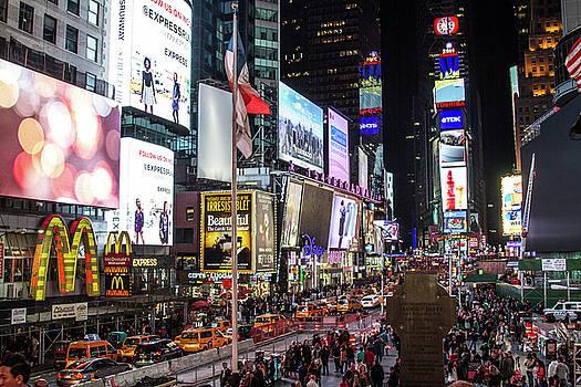 Times Square  by Robert J Caputo