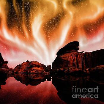 Aurora over lagoon by Atiketta Sangasaeng