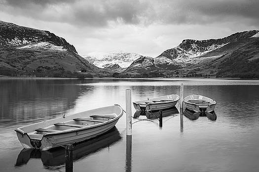 Beautiful  black and white Winter landscape image of Llyn Nantll by Matthew Gibson