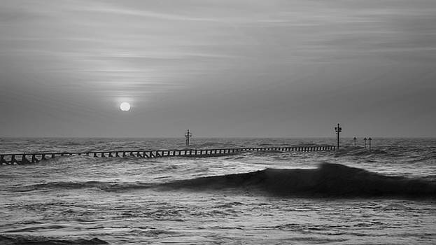 Beautiful dramatic black and white stormy landscape image of wav by Matthew Gibson