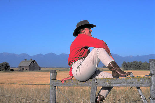 Cow Girl on a Fence in Montana by Carl Purcell