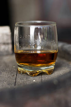 Glass of whiskey in distillery by Newnow Photography By Vera Cepic