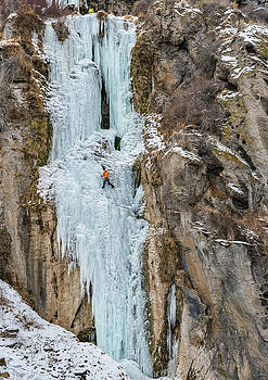 Greg Moore climbing Lower Falls Right rated WI4 Near Shoshone Fa by Elijah Weber