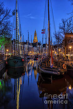 Groningen at night with boats and lights by Patricia Hofmeester