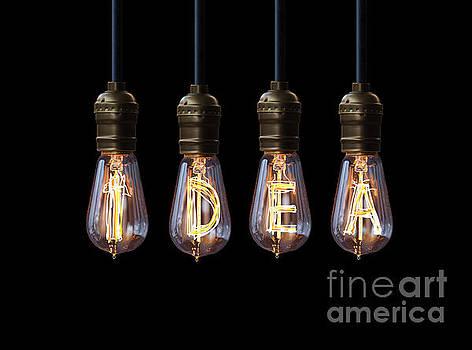 Light Bulb Background by Setsiri Silapasuwanchai