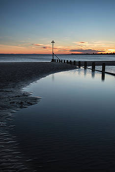 Beautiful vibrant Spring sunset long exposure beach landscape by Matthew Gibson
