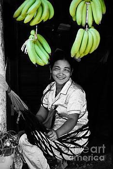 A Cambodian lady sitting in hammock selling bananas in Sihanoukville by Mirko Dabic