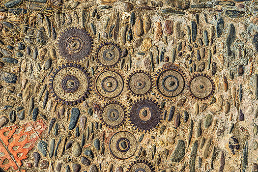 Eduardo Huelin - Pavement texture with gears and bricks in Montjuic Barcelona Spain