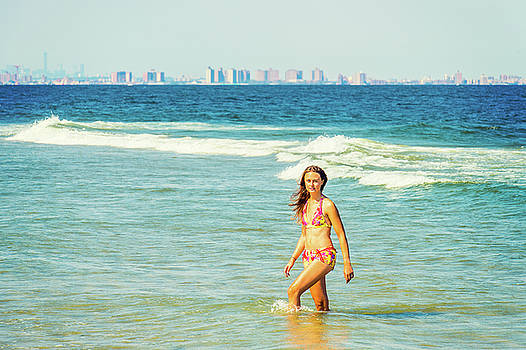 Alexander Image - Young American Woman traveling, relaxing on the beach in New Jer