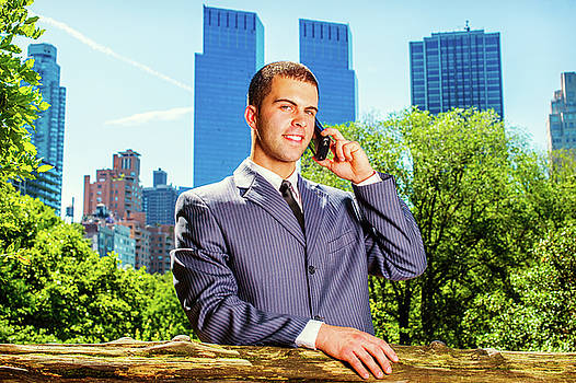 Alexander Image - Young American Businessman talking on cell phone, traveling, wor