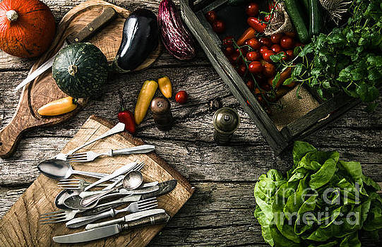 Organic vegetables on wood by Mythja Photography