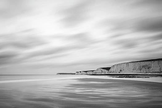 Stunning black and white long exposure landscape image of low ti by Matthew Gibson