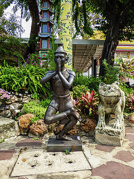 Thai Yoga statue at famous Wat Pho Temple by Helissa Grundemann