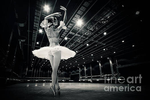 Dimitar Hristov - A beautiful ballerina dancing in studio
