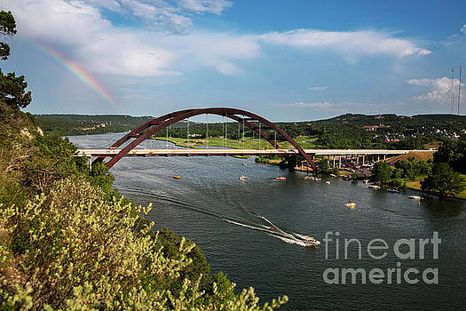 Herronstock Prints - A beautiful rainbow towers over the 360 Bridge as boaters take t