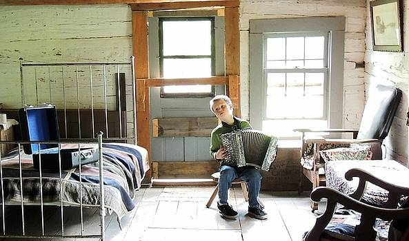 A Boy an Accordion and a Log Cabin by Mikel Classen