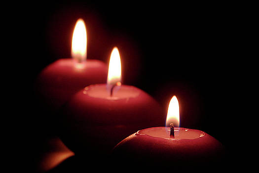 A candle loses nothing by lighting another candle. by Fir Mamat