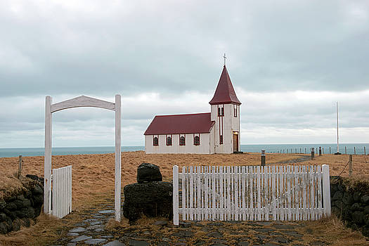 A church with no fence by Dubi Roman