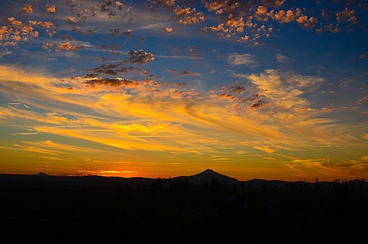 A colorful swirl sunset by Linda Larson