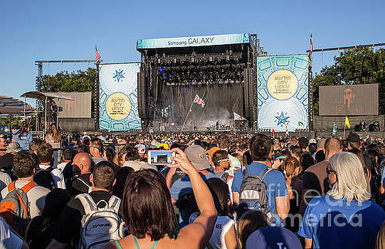 Herronstock Prints - A concert goer snaps a photo of the stage during the Austin City Limits Music Festival
