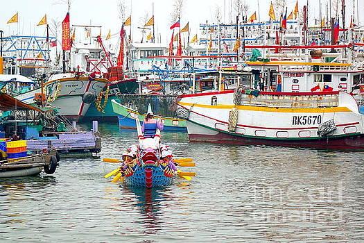A Dragon Boat in a Taiwan Fishing Port by Yali Shi