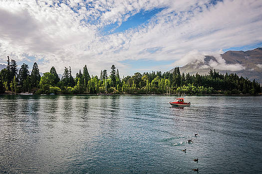 A fishing boat on the shore of Lake Wakatipu by Daniela Constantinescu