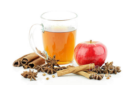 A glass of tea with apple and spices,on a white background. by Paul Koomen