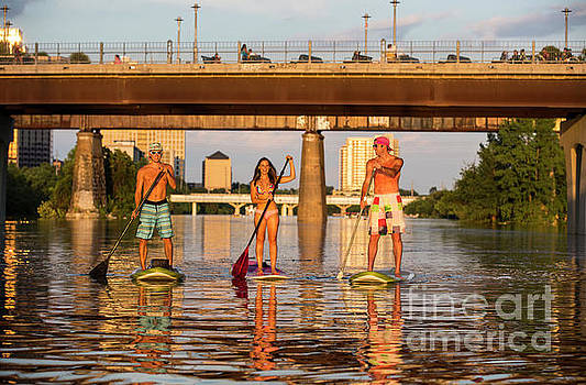 Herronstock Prints - A group of friends navigate Lady Bird Lake in Austin Texas the Stand Up Paddle SUP Capital of the world